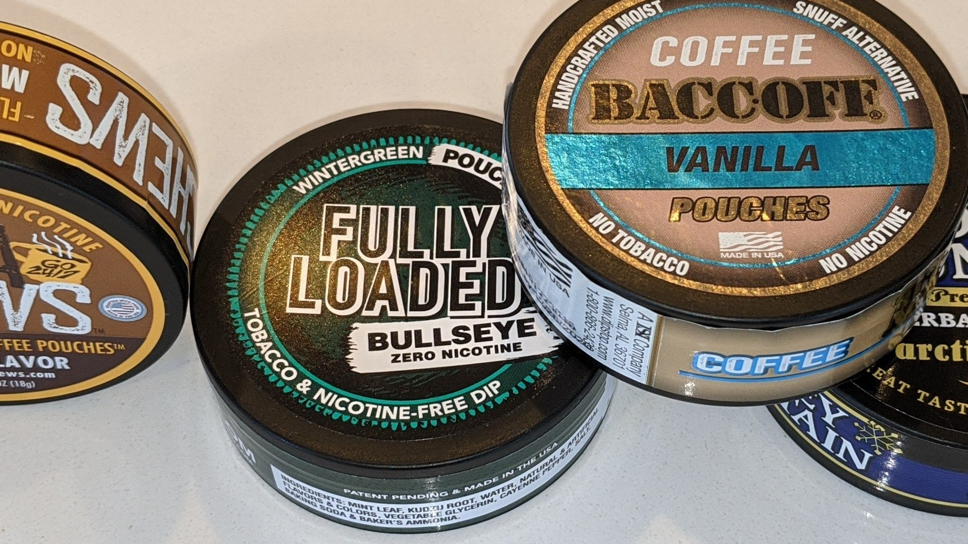 Plastic cans and tins for non-tobacco coffee pouches.